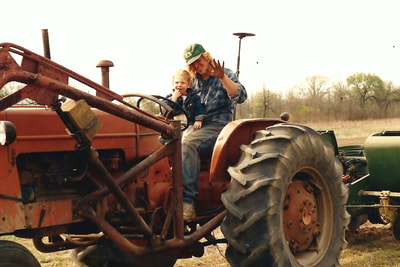 Chris Jaworski and Son on Tractor at Jaworski Farm Market